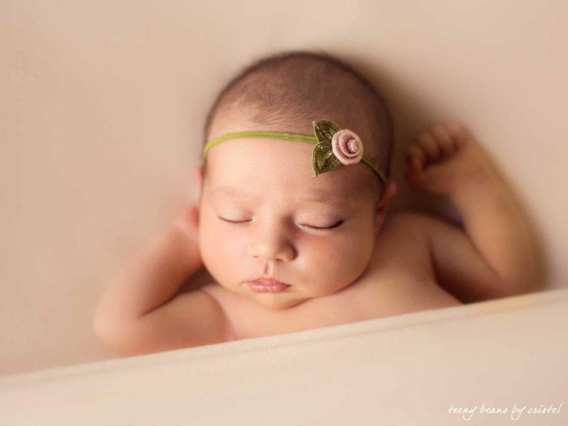 raleigh newborn photographer - baby sleeping flower color
